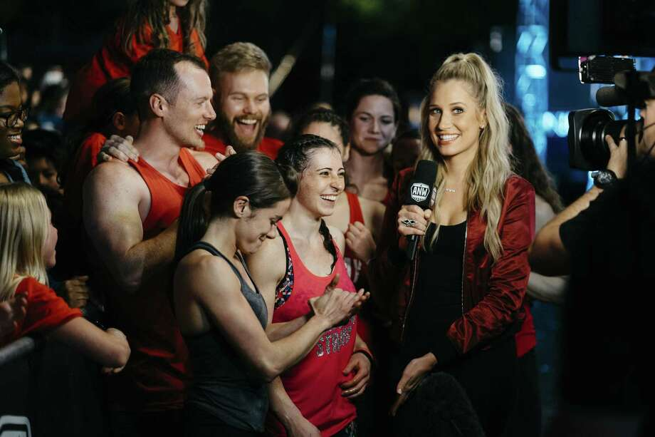 """San Antonio favorite Kacy Catanzaro and Houston-area dynamo Barclay Stockett were quizzed by """"American Ninja Warrior"""" correspondent Kristine Leahy at the S.A. finals. They were the only two women to advance to the national finals in Vegas, which will be broadcast in coming weeks on NBC. Photo: NBC / 2017 NBCUniversal Media, LLC"""