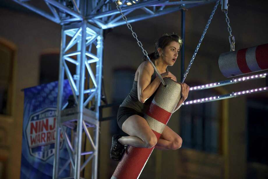 """Kacy Catanzaro tackles one of the tougher obstacles of the San Antonio finals on """"American Ninja Warrior,"""" She advanced to the Las Vegas finals, which start Monday on NBC. Photo: NBC / 2017 NBCUniversal Media, LLC"""
