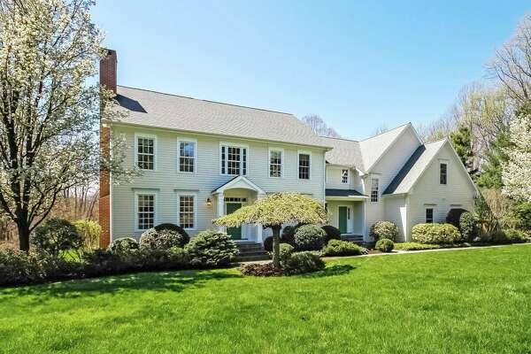 The custom clapboard colonial house at 3781 Congress Street is located on a 2.3-acre property adjacent to the Haydu Farm, which is owned by the Town of Fairfield.