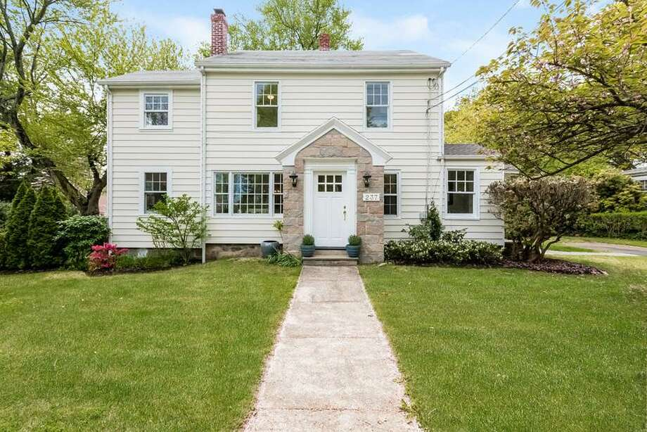 The white colonial house at 237 Noroton Avenue sits on a level corner lot of about a third of an acre along West Elm Street. Photo: Contributed Photos