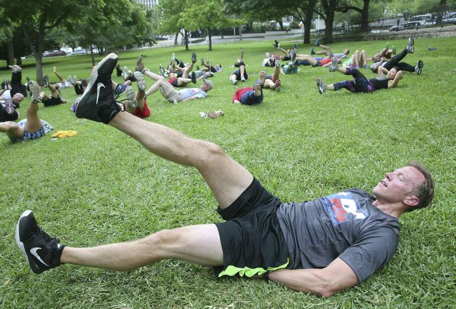 Texas Railroad Commissioner Ryan Sitton leads a workout group on the lawn of the State Capitol in honor of Global Employee Health and Fitness Month and in collaboration with the American Heart Association on May 10, 2017.  Land Commissioner George P. Bush shared the lead at noon hour on the Capitol grounds. Photo: Tom Reel, Staff / San Antonio Express-News / 2017 SAN ANTONIO EXPRESS-NEWS