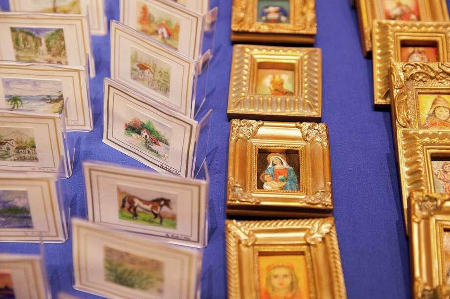Martha I. Ochoa's many miniature paintings were done with acrylics, oils and watercolors. Photo: Julysa Sosa /Contributor