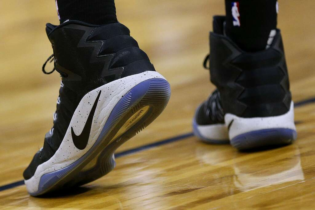 Pau Gasol of the San Antonio Spurs sports a pair of black and white Nikes  during