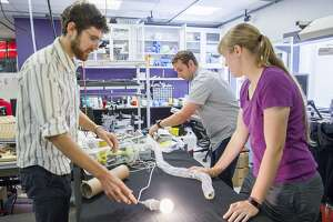 From left: UC Santa Barbara assistant professor and mechanical engineer Elliot Hawkes with Stanford graduates Joey Greer and Laura Blumenschein demonstrate how the vine-like robot grows and navigates at the Mechanical Engineering Research Lab on Friday, July 28, 2017, in Stanford, Calif. One of the applications the robot may be used for is search and rescue. With it's exterior made out of a low-density polyethylene plastic, the robot may navigate through clutter and squeeze through places deemed too dangerous or small for humans. The robot moves and grows with controlled air pressure.