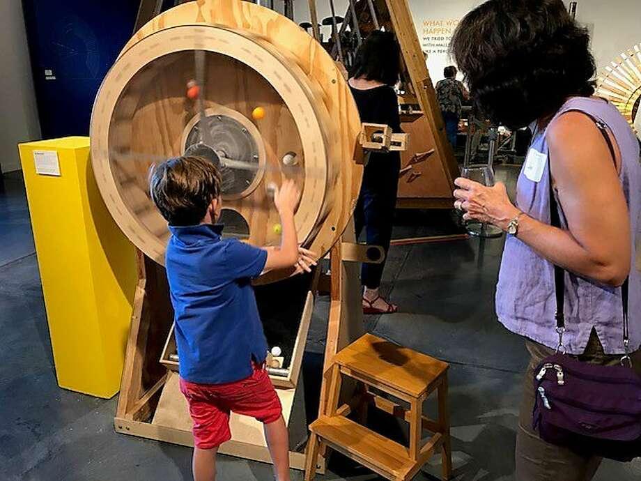 """Felix Boucou at Paul Dresher's """"Sound Maze"""" exhibition. Photo: Leah Garchik, San Francisco Chronicle"""