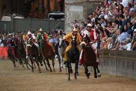 "Riders compete in the historical Italian horse race ""Palio di Siena"" on July 2, 2017 in Siena.  / AFP PHOTO / AFP or Licensors / Claudio GiovanniniCLAUDIO GIOVANNINI/AFP/Getty Images"