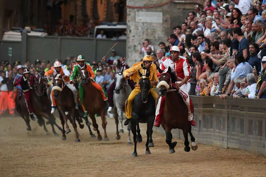 "Riders compete in the historical Italian horse race ""Palio di Siena"" last month. In the race, riders representing 10 neighborhoods vie for citywide bragging rights. Photo: CLAUDIO GIOVANNINI, AFP/Getty Images"
