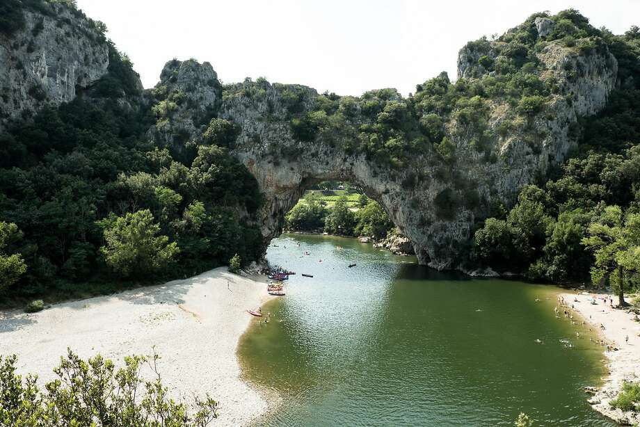 An enormous natural archway called the Pont de l'Arc hangs 200 feet above the valley floor in the Ardche Gorges. Photo: Mark Sissons, Special To The Chronicle