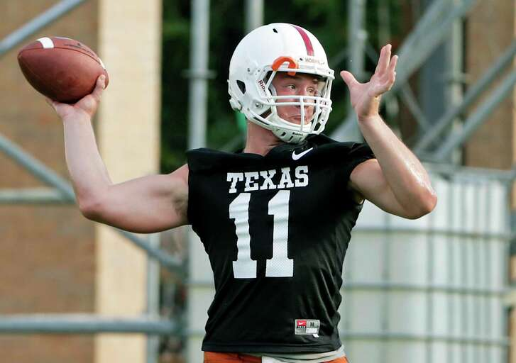 Quarterback Sam Ehlinger goes through drills asthe Longhorns begin their fall football practice at Frank Denius Fields at the University of Texas on July 31, 2017.