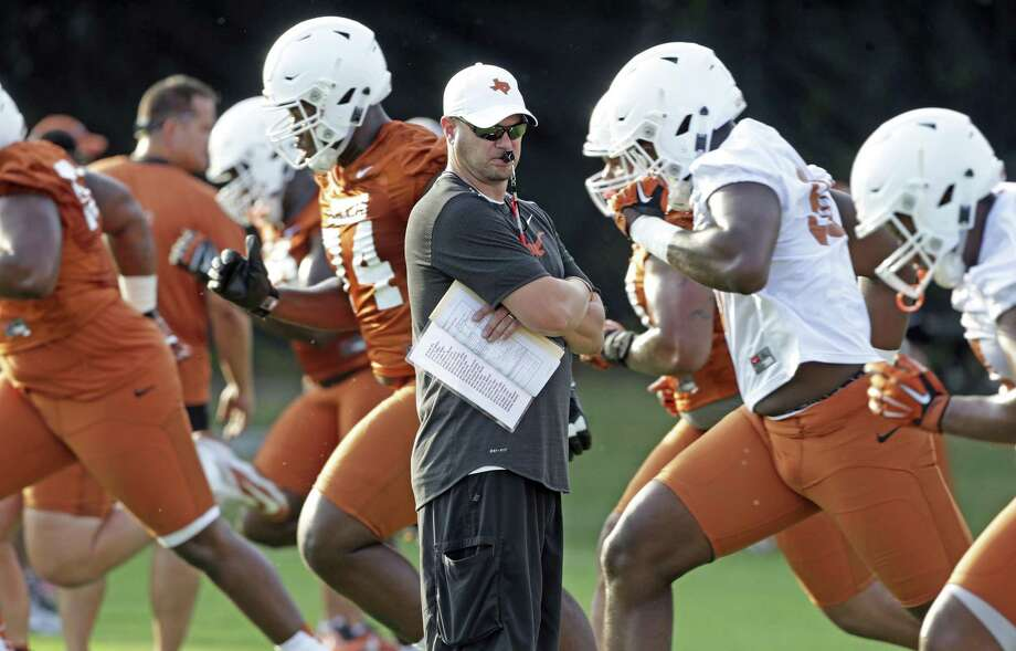 UT football coach Tom Herman watches his players warm up before practice at Denius Fields in Austin on July 31, 2017. Photo: Tom Reel /San Antonio Express-News / 2017 SAN ANTONIO EXPRESS-NEWS