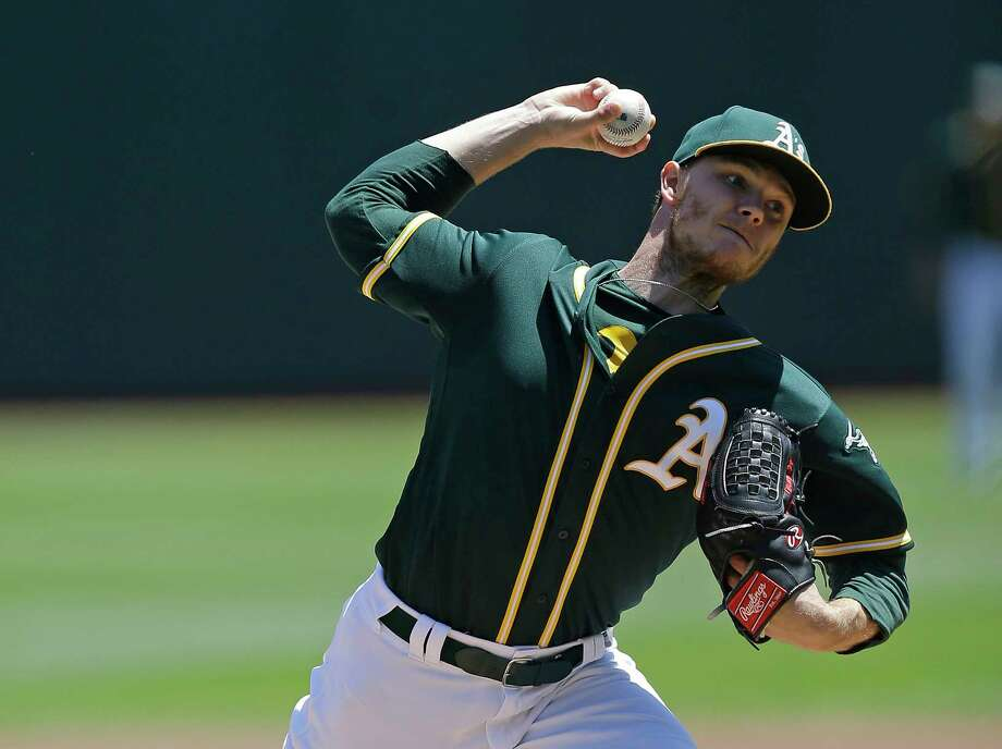 FILE - This July 19, 2017 file photo shows Oakland Athletics pitcher Sonny Gray working against the Tampa Bay Rays in the first inning of a baseball game in Oakland, Calif. Gray has been traded, Monday, July 31, 2017, to the Yankees from the Athletics for three prospects, boosting New York's starting rotation for an unexpected playoff run. (AP Photo/Ben Margot, file) Photo: Ben Margot, STF / Copyright 2017 The Associated Press. All rights reserved.