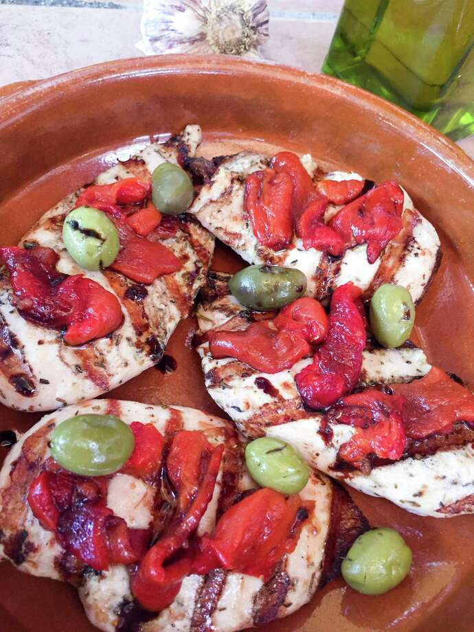 Roasted peppers and an interesting mix of olives will elevate Chicken Breast Provencal. Rosé wine is best in the dish, but a white wine also will work. Photo: Melissa D'Arabian, UGC / Melissa d'Arabian