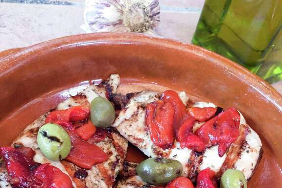 Roasted peppers and an interesting mix of olives will elevate Chicken Breast Provencal. Rosé wine is best in the dish, but a white wine also will work.