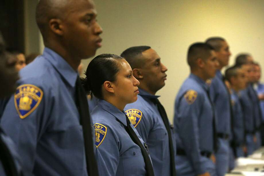 The San Antonio Police Department's 2017C Cadet Class stands at attention July 31 during a welcoming ceremony at the San Antono Police Training Academy. The class was made up of 44 males and seven females. The city is just now filling gaps in police staffing. Photo: John Davenport /San Antonio Express-News / ©John Davenport/San Antonio Express-News