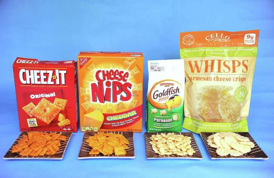 From left:Cheez-It (Original) Crackers, Cheese Nips Crackers,Goldfish Parmesan Crackers, Whisps Photo: Pam Panchak, MBR / Pittsburgh Post-Gazette