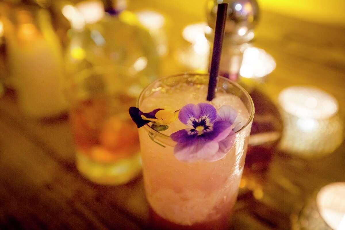 Rabbit Hole Sunrise consists of Casa Noble Reposado tequila, bergamot juice, yuzu juice and butterfly pea tea syrup.