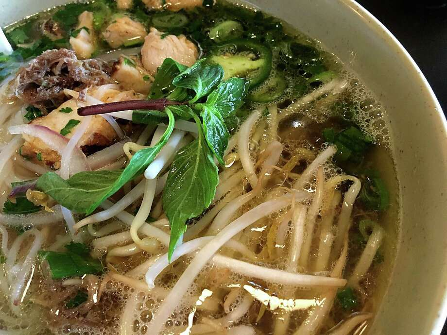 San Antonio Pho gets barbacoa and chicken fajita at Suck It: The Restaurant. Photo: Mike Sutter /San Antonio Express-News