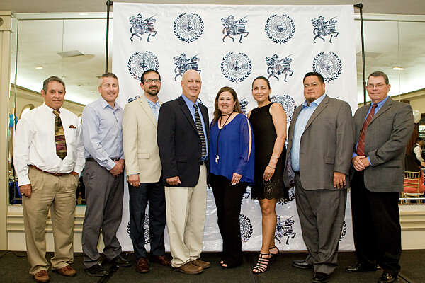 St. Augustine High School Principal Olga Gentry and Athletics Director Rodrigo Romo (middle) accompanied by varsity head coaches Mario Garcia, Robert Serna, Eduardo Valdez, Clarissa Mancha, Hector Macias, Larry Turner during a banquet held for the sports teams at La Pozada on Tuesday evening.
