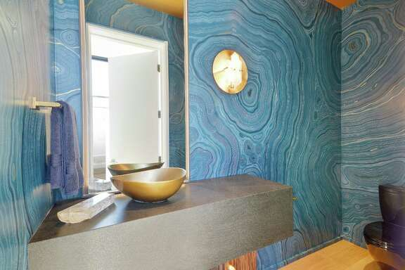 Concentric circles provide a nautical element to this powder room's design.