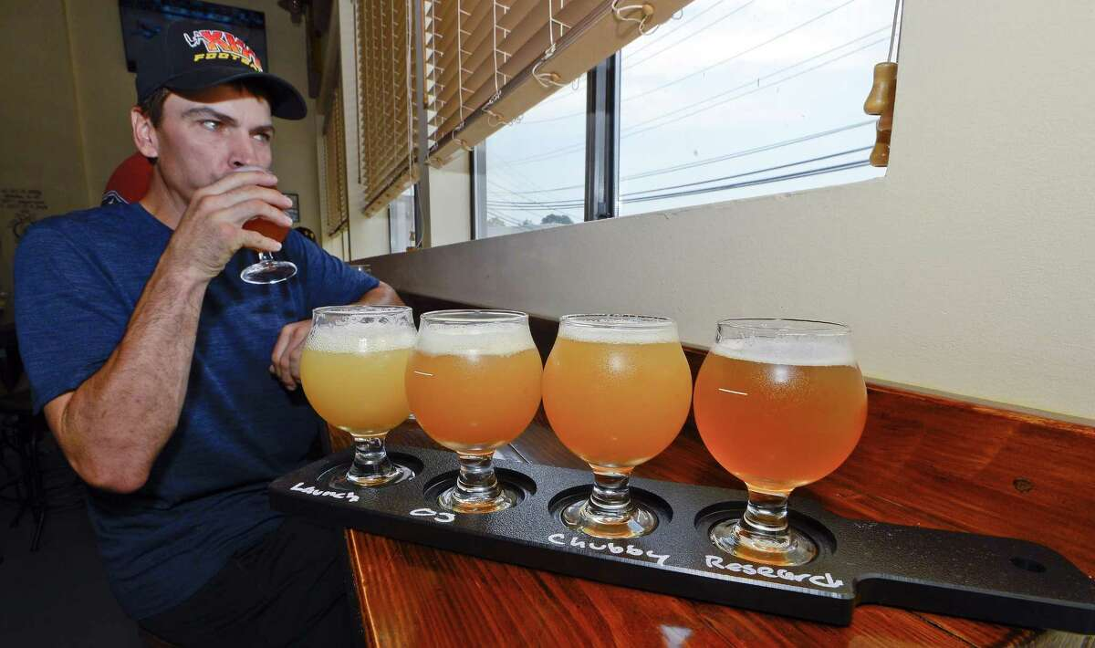 Scott Backun of Stamford enjoy's a fresh IPA from Lock City Brewing as he samples a flight of Launch, OJ, Chubby and Research Ales during the Grand Opening of the new brewery on Saturday, July 22, 2017 in Stamford, Connecticut.