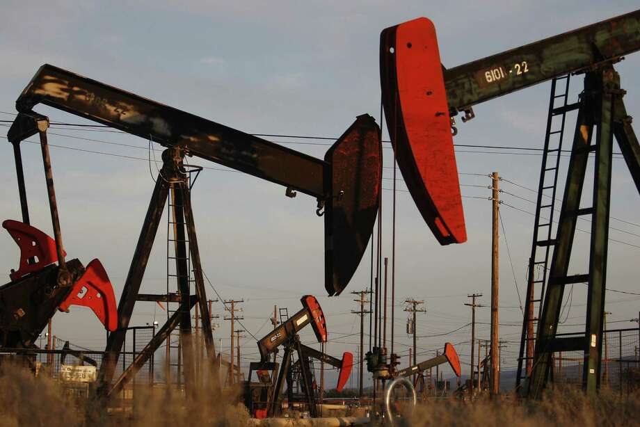 File photo of pump jacks and wells. Penn Virginia Corp. is buying nearly 20,000 acres in the Eagle Ford Shale oil field from Devon Energy in a deal worth $205 million, the companies announced Monday. Photo: David McNew /Getty Images / David McNew