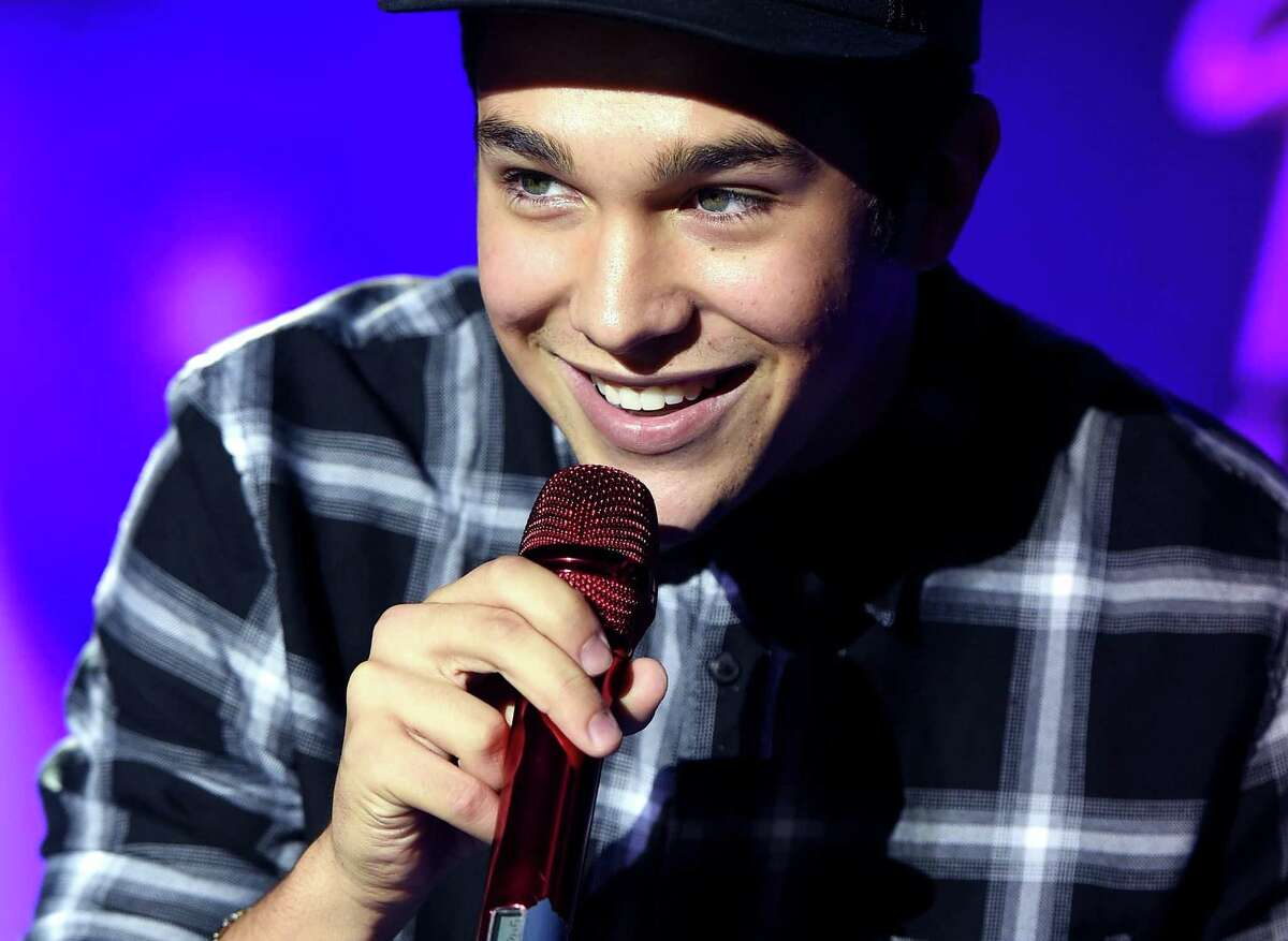 """YouTube subscribers: 1.5 million Most watched video: cover of Justin Bieber's """"Mistletoe,"""" 17.35 million views Sometimes called the second coming of Justin Bieber, singer Austin Mahone has found his way from his San Antonio home to the stage of the MTV Video Music Awards, where he was named artist to watch in 2013. Mahone got his start on YouTube making homemade music videos in January 2011 at the age of 14. His cover of Justin Bieber's """"Mistletoe"""" that October skyrocketed him to fame."""
