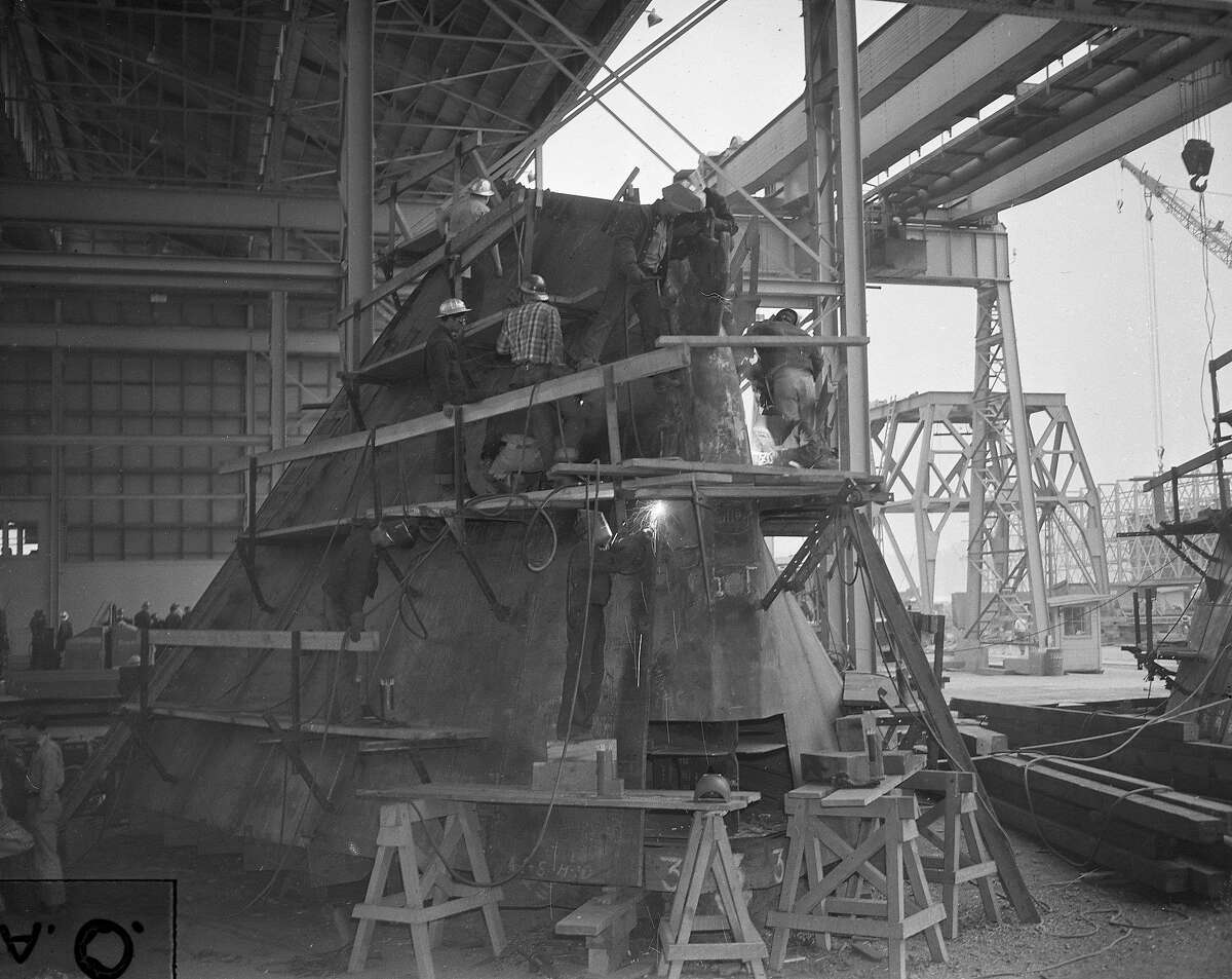 Workers building ships at Marinships