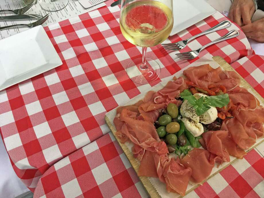 At Cotto wine bar in Stamford, sommelier and general manager Ian Toogood paired a sauvignon blanc and pinot grigio blend, Due Uve, Bertani, with an antipasto on a recent summer evening. Photo: Christina Hennessy / Hearst Connecticut Media / Connecticut Post