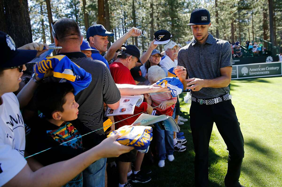 Golden State Warriors' Stephen Curry stops to sign autographs during the 2016 American Century Celebrity-Amateur Tournament in Lake Tahoe, Nevada, California, on Thurs. July 22, 2016.