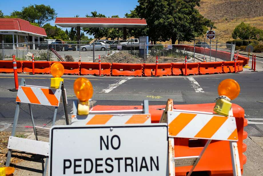 A sinkhole at the intersection of Center Avenue and Rheem Street is barricaded in Moraga on July 17, 2017. Photo: Gabrielle Lurie, The Chronicle