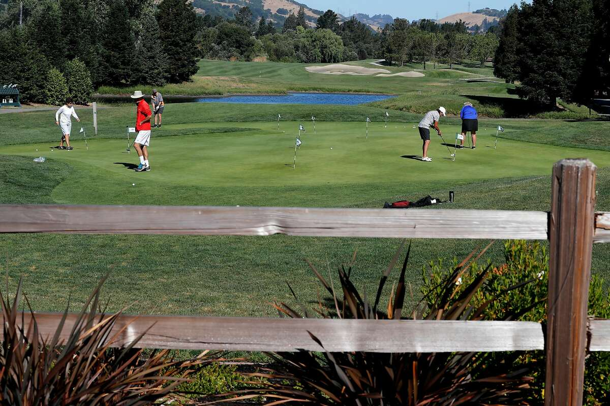 Warming up on the putting green at the Moraga Country Club. The affluent town doesn't have enough in its reserve fund to repair a sinkhole and is seeking federal help.
