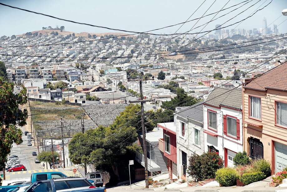 The Woolsey Street site in the Portola, where a community garden grows, may be the site of two competing visions — one for an urban agriculture center, one for housing. Photo: Scott Strazzante, The Chronicle