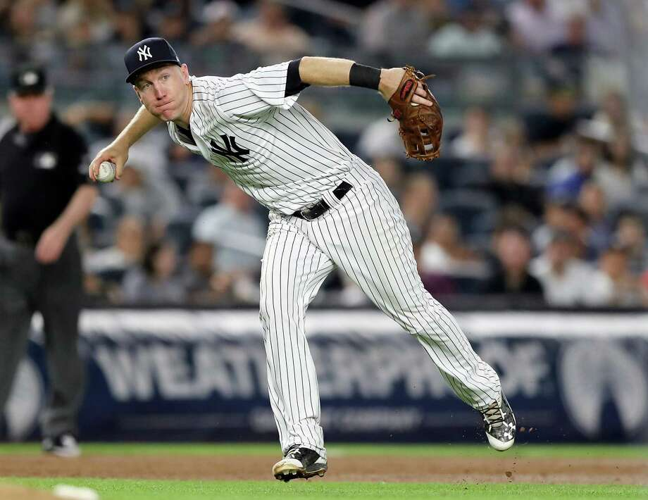 NEW YORK, NY - JULY 27:  Todd Frazier #29 of the New York Yankees sends a hit by Evan Longoria of the Tampa Bay Rays to first for the out in the fifth inning on July 27, 2017 at Yankee Stadium in the Bronx borough of New York City. Photo: Elsa, Getty Images / 2017 Getty Images