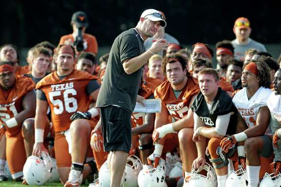 Longhorns coach Tom Herman has the full attention of his players during the team's first fall practice of the season on Monday in Austin.