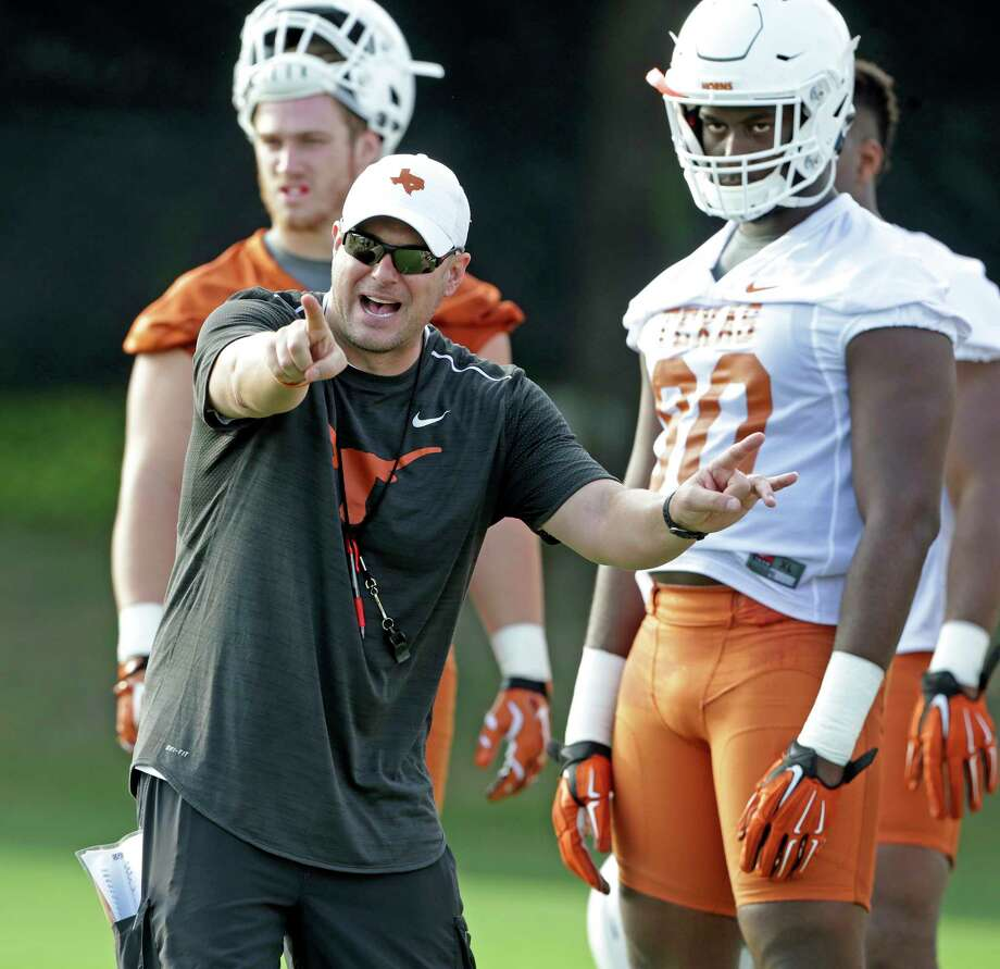 Coach Tom Herman spends time with linemen as the Longhorns begin their fall football practice at Frank Denius Fields at the University of Texas on July 31, 2017. Photo: Tom Reel, Staff / 2017 SAN ANTONIO EXPRESS-NEWS