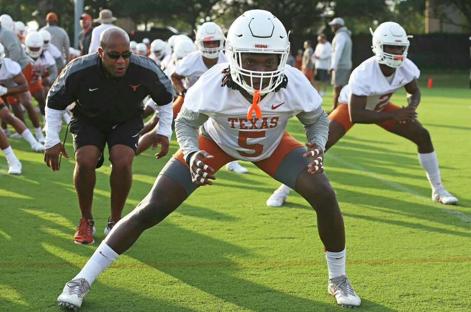 Defensive back Holton Hill gets some scrutiny as he stretches in warm up as the Longhorns begin their fall football practice at Frank Denius Fields at the University of Texas on July 31, 2017. Photo: Tom Reel, Staff / 2017 SAN ANTONIO EXPRESS-NEWS