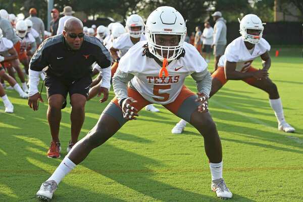 Defensive back Holton Hill gets some scrutiny as he stretches in warm up as the Longhorns begin their fall football practice at Frank Denius Fields at the University of Texas on July 31, 2017.