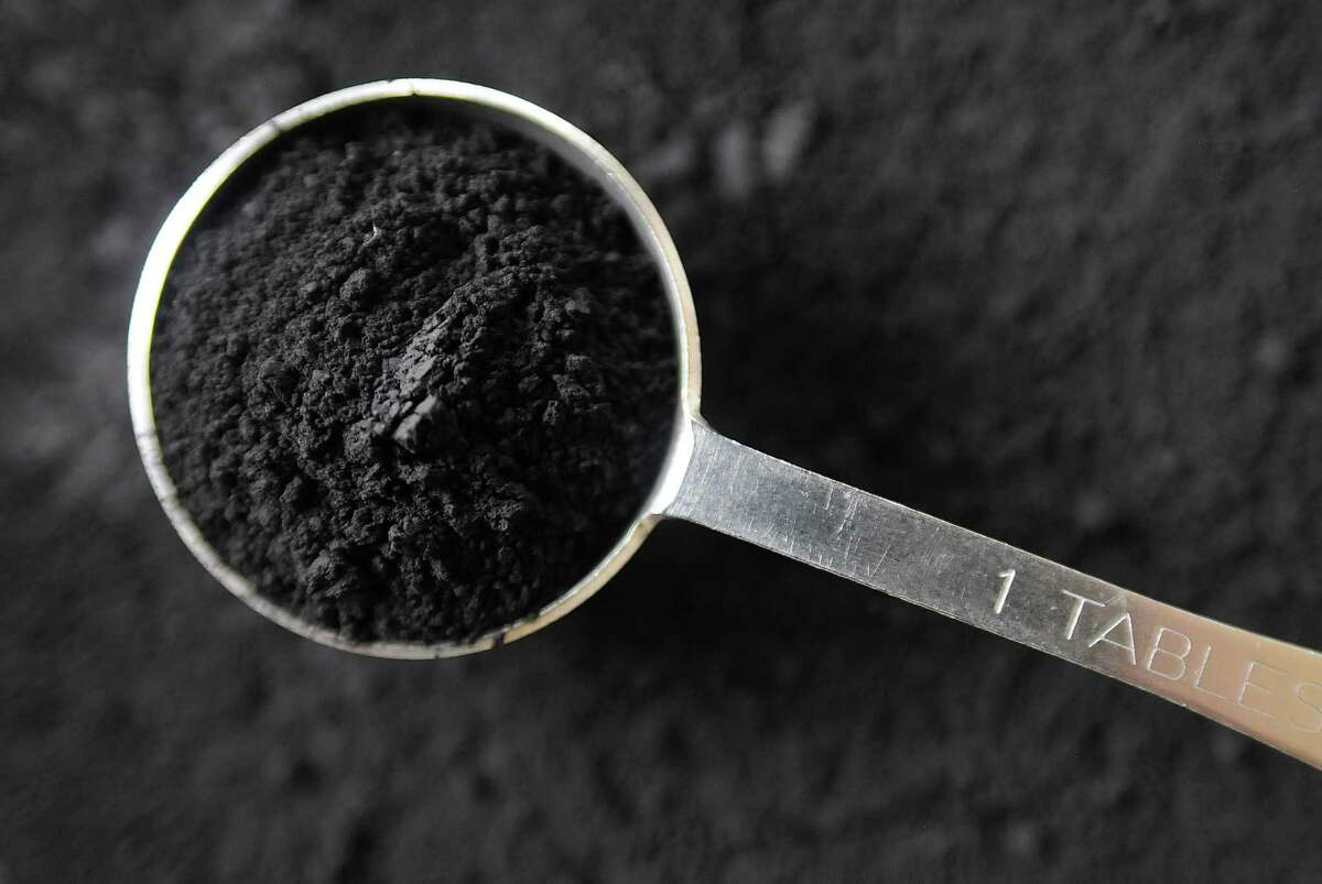 Activated charcoal is an increasingly popular supplement used to color food items a dramatic black.