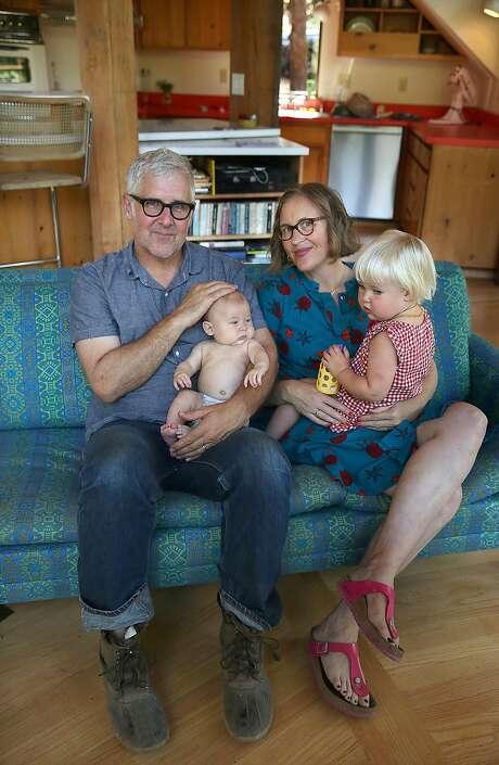 James Freeman holds baby Monroe and Caitlin Williams Freeman holds Linden. Photo: Liz Hafalia, The Chronicle