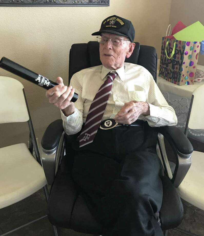 """Texas A&M's Association of Former Students helped Tom C. """"Ike"""" Morris celebrate his 107th birthday in San Antonio this weekend. Texas A&M head track coach Pat Henry sent greetings and this relay baton. Morris, who was a hurdler, joked, """"They should have sent a hurdle."""" Photo: Texas A&M's Association Of Former Students / Texas A&M's Association of Former Students"""