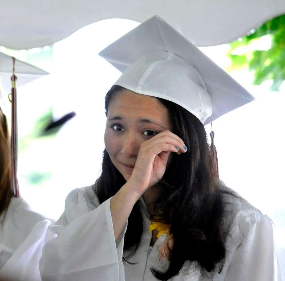 Laina Emily Piera wipes away a tear during Wooster School Commencement in Danbury, on Saturday, June 12, 2010. Photo: Michael Duffy / The News-Times
