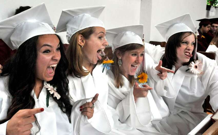 Graduates have a lighthearted moment just before Wooster School Commencement in Danbury, on Saturday, June 12, 2010. From left are Laura Chautin, Chloe Woodhouse, Annie Keeler, and Katie Kelly.