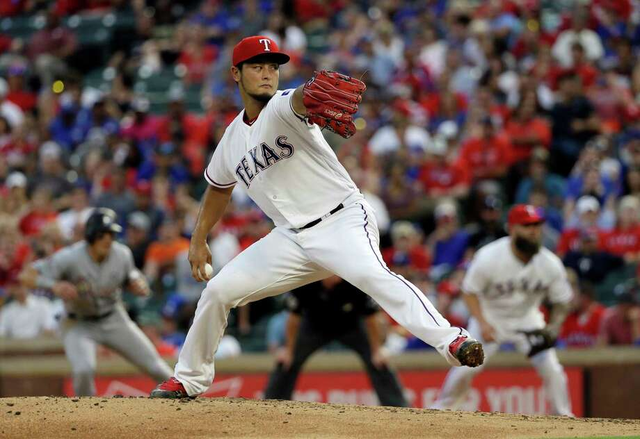 FILE - In this July 26, 2017, file photo, Texas Rangers' Yu Darvish throws to against the Miami Marlins in the fourth inning of a baseball game, in Arlington, Texas. As the hours tick down to baseball's trade deadline, three standout pitchers remain at the center of attention. Sonny Gray, Justin Verlander and Yu Darvish each have the potential to help a contending team down the stretch, and if any of them are traded Monday, July 31, 2017, it would certainly spice up what has been a fairly pedestrian stretch of deals so far. (AP Photo/Tony Gutierrez, File) Photo: Tony Gutierrez, STF / Copyright 2017 The Associated Press. All rights reserved.
