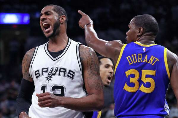 Golden State Warriors' Kevin Durant and the Spurs' LaMarcus Aldridge react to an Aldridge turnover in the second quarter during Game 3 of NBA Western Conference finals at the AT&T Center on May 20, 2017.