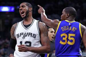 Golden State Warriors' Kevin Durant and San Antonio Spurs' LaMarcus Aldridge react to an Aldridge turnover in 2nd quarter during Game 3 of NBA Western Conference Finals at AT&T Center in San Antonio, Texas, on Saturday, May 20, 2017.