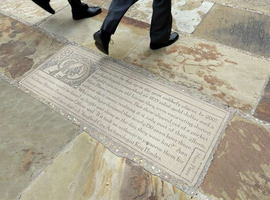 Engraved stones on the grounds of the Bexar County Courthouse, including this one seen June 28, offer up odd little news tidbits from history. Photo: William Luther /San Antonio Express-News / © 2017 San Antonio Express-News