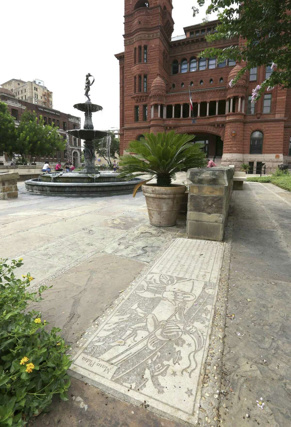 Engraved stones on the grounds of the Bexar County Courthouse, offer commentary, history.