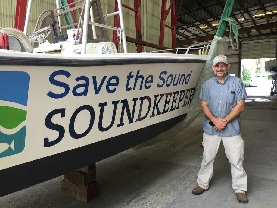 Wilton native Bill Lucey and the Soundkeeper boat, the Terry Backer. Photo: Contributed Photo