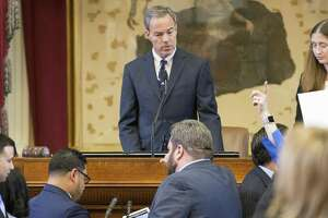 House Speaker Joe Straus, center, watches as representatives vote on the House floor at the Texas Capitol last week