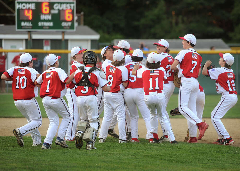 The Fairfield American baseball team celebrates their 6-4 victory over Newington in Guilford, Conn. on Monday, July 31, 2017. Photo: Brian A. Pounds, Hearst Connecticut Media / Connecticut Post